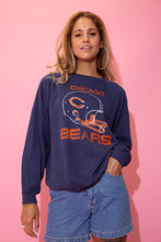 Load image into Gallery viewer, Navy blue in colour, this jumper has a large orange 'Chicago Bears' spell-out across the front with an orange and white helmet print on the front.