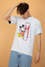 Load image into Gallery viewer, This grey tee has a large Mickey Mouse print on the front with a large red 'M' next to it. Finished off with blue foldable sleeves and a blue double-layered collar.