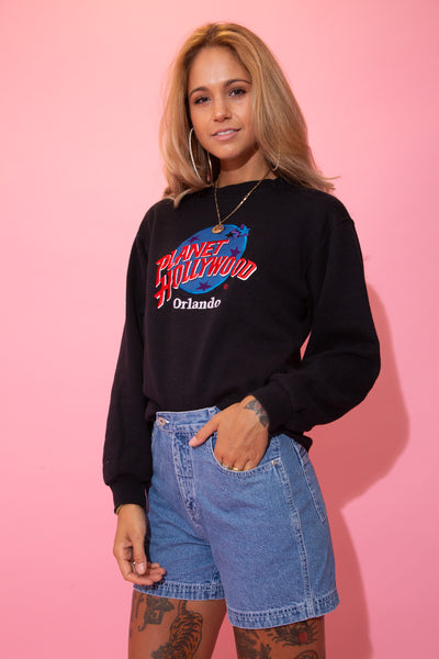 Black in colour, this jumper has a large embroidered 'Planet Hollywood' logo on the front repping Orlando below.