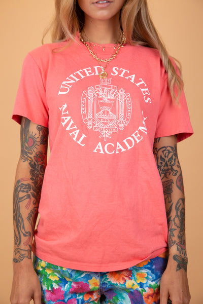 "pink single stitch tee with white graphic on the front that says ""United States Naval Academy"""