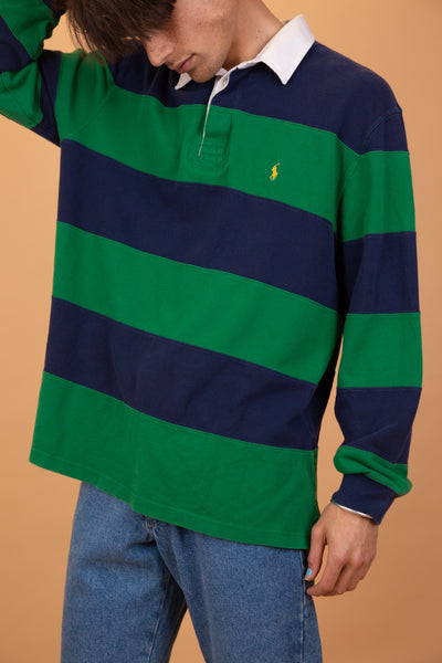 Long sleeved Ralph Lauren Polo rugby sweater with green and blue horizontal stripes, a white button up collar and yellow Ralph Lauren branding on the left chest.