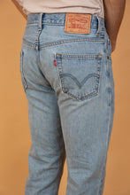 Load image into Gallery viewer, Levis 505 Jeans with a regular straight leg fit and light wash blue colouring. Finished off with light brown stitching and branding on the back waistline, button and domes.