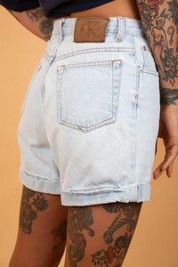 light-wash denim shorts with calvin klein patch on the back