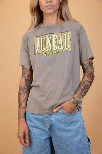 "khaki green tee with ""juneau alaska"" on the front. single stitched vintage from magichollow"