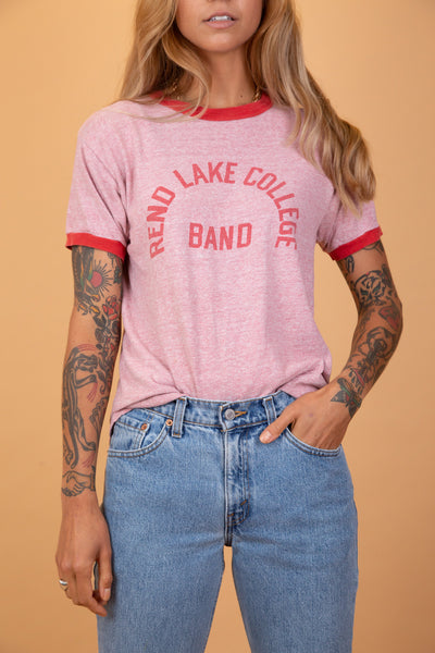 "pink tee with ""rend lake college band"" on the front"