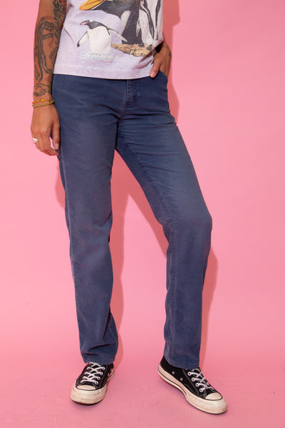 Blue in colour, these pants are in a corduroy material in a slightly tapered leg style with Levi's branding on the button, domes, back pocket and back waistline.