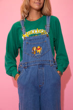 Load image into Gallery viewer, Mid-wash blue dungarees with brown stitching, a straight leg fit and our fav childhood friends, Pooh Bear and Tigger, embroidered on the front chest pocket.