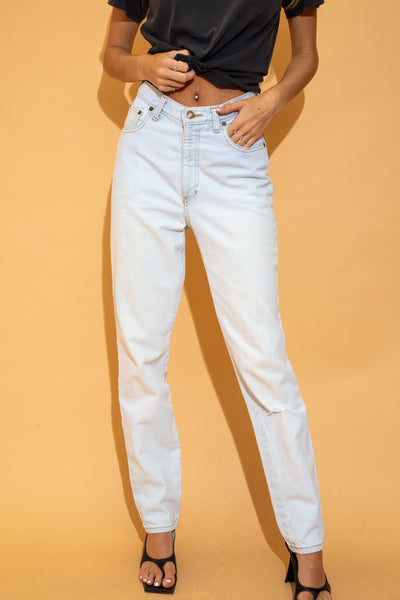 the model is wearing light washed denim jeans