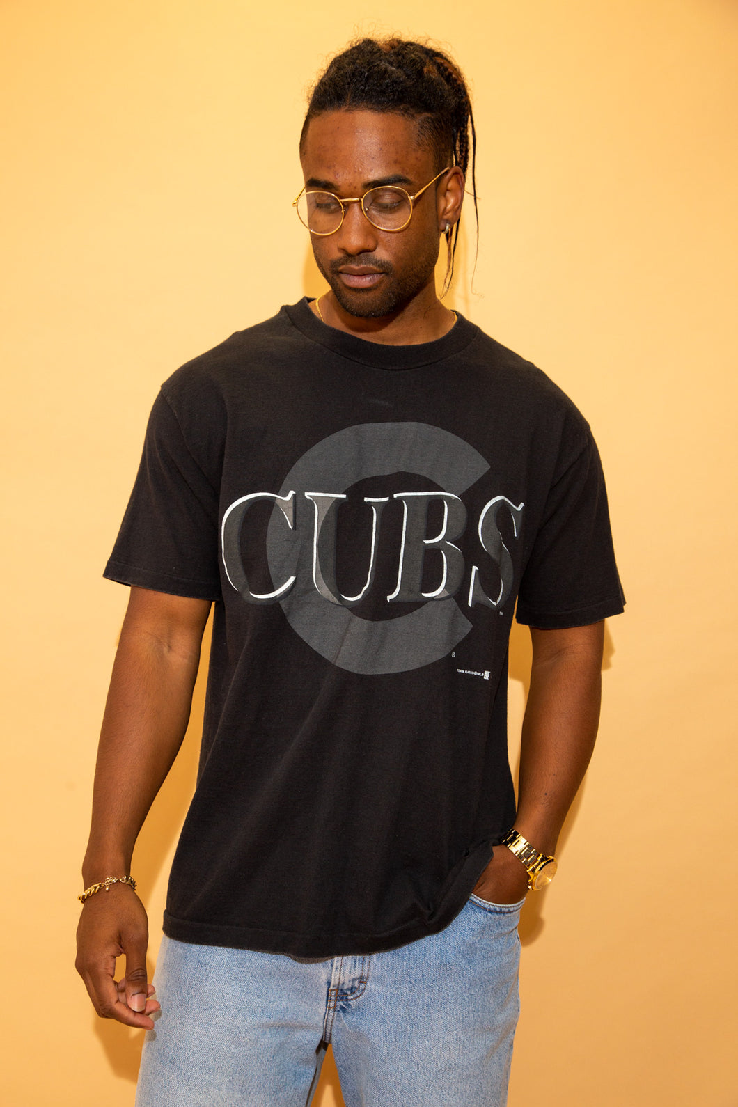 Black single-stitch tee with a large Cubs spell-out in grey and a matching coloured C in the background. Dated 1992.