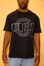 Load image into Gallery viewer, Black single-stitch tee with a large Cubs spell-out in grey and a matching coloured C in the background. Dated 1992.