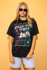 Black in colour, this single stitch tee has a coloured grid print, a spaceship and 'stalk the night' printed in a splatter design on the front. Repping Tenopah Tee Range below.