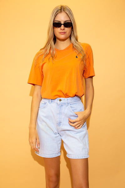 With its v-neck design and bright orange colour, this single-stitch tee is finished off with a navy blue Ralph Lauren logo on the left chest.