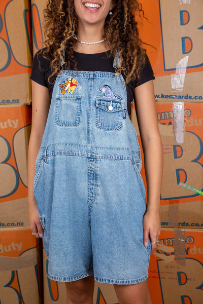 Light wash blue, these Disney dungarees have colourful appliqués of pooh, tigger and Eeyore above the two breast pockets. Finished off with side pockets, belt loops and branded buttons.
