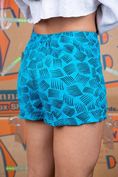 the model wears turquoise shorts