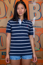 Load image into Gallery viewer, the model wears a navy and white striped polo