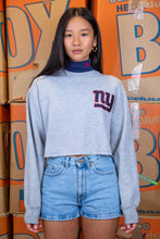 Load image into Gallery viewer, the model wears a grey sweater with a navy turtleneck detail