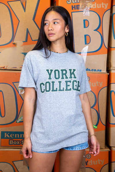 Grey in colour, this single stitch tee has a large green and white 'York College' spell-out across the front.