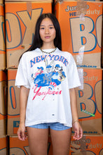 Load image into Gallery viewer, the model wears a distressed white tee with a looney tunes and new york yankees graphic on the front
