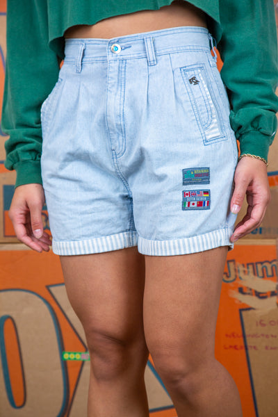 the model is wearing a \pair of light wash denim shorts