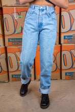 Load image into Gallery viewer, Light-wash blue, these jeans have a tailored waist, mom-jean style, white stitching and branding on the back waistline, left pocket, domes and button.
