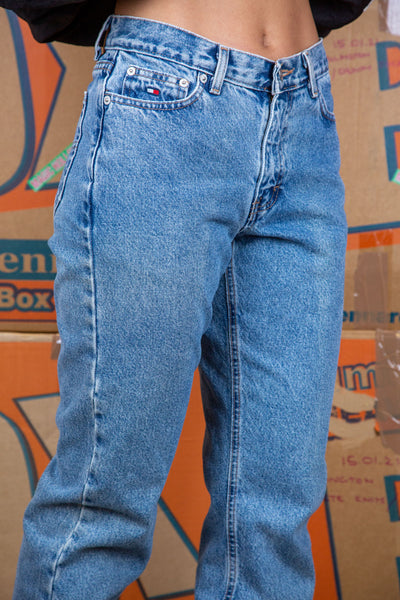 Mid-wash blue in colour, these must-have jeans have a slightly tapered leg in a. mom-style fit.