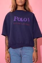 Load image into Gallery viewer, Navy blue in colour, this sweater has a capitalised purple 'POLO' spell-out across the front with the logo next to it. Repping Ralph Lauren below in red below