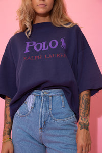 Navy blue in colour, this sweater has a capitalised purple 'POLO' spell-out across the front with the logo next to it. Repping Ralph Lauren below in red below