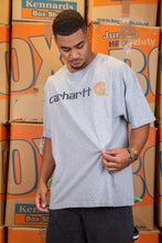 Load image into Gallery viewer, Grey in colour, this tee has a black 'Carhartt' spell-out across the front with a brown Carhartt logo on the left.