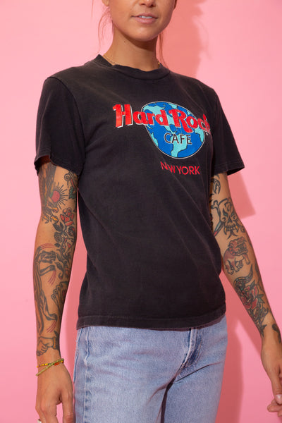 Black in colour, this single stitch tee has a green, blue and red Hard Rock Cafe logo on the front, repping New York below.