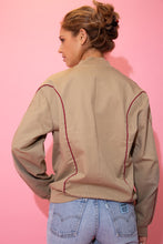 Load image into Gallery viewer, Brown in colour, this jacket has maroon trim across the bodice with a maroon Converse logo on the left chest. With a ribbed neckline, cuffs and waistline, in a bomber jacket style