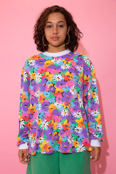 the model wears a floral long sleeved top