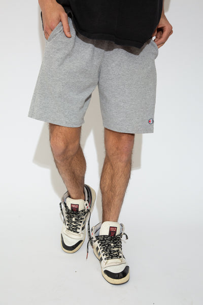 These Champion sweat-shorts are light grey with an elasticated waist, pockets and Champion branding on the left leg.