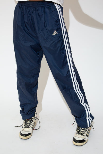 model wearing adidas track pants, magichollow