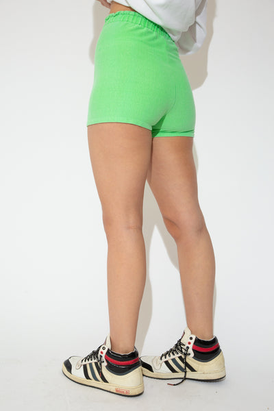 model wearing neon green shorts, magichollow
