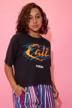 Load image into Gallery viewer, the model wears a black crop with a cali florida graphic on the front