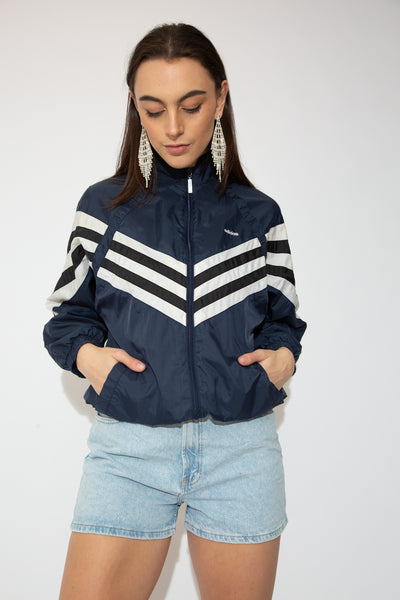model wearing adidas jacket, magichollow
