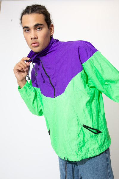 Catch some eyes and break some hearts in this Sport Europa Quarter-Zip! With its luminous purple and green colour way, Anorak feel and quarter-zip style