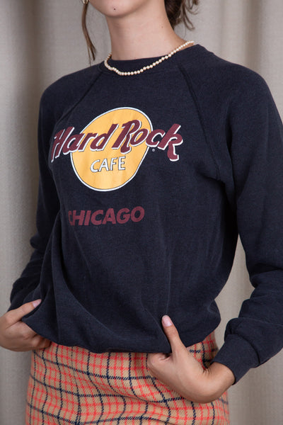 the model wears a hard rock chicago sweater
