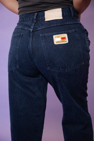 Dark wash blue in a straight leg fit, these mom-style jeans have Tommy Hilfiger branding on the back right pocket and inner waistline.