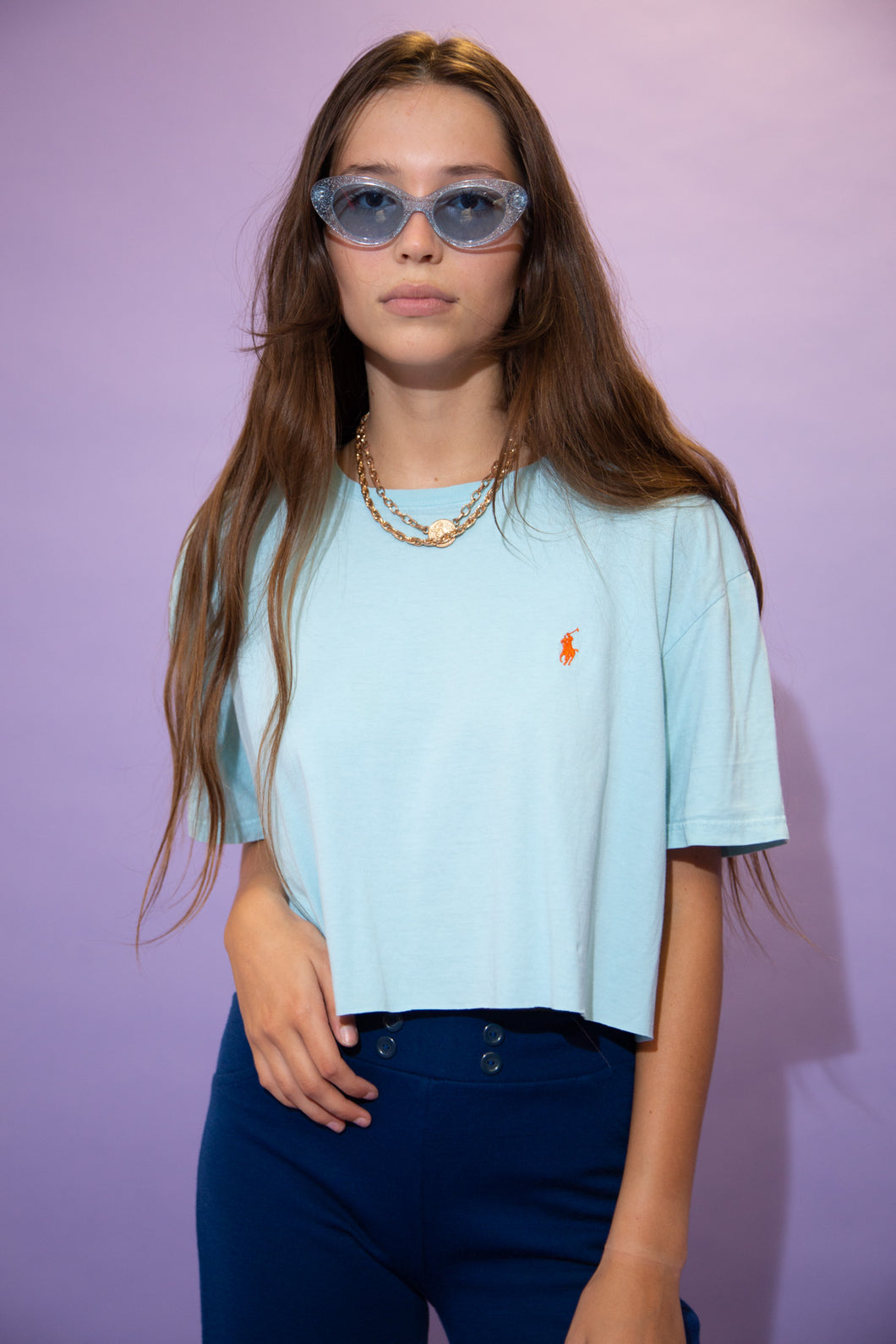 Baby blue in colour, this tee has an orange embroidered Ralph Lauren logo on the left chest. Cropped to keep it cute.
