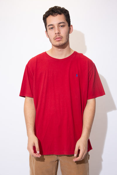 Red tee in a crew neck style with a blue embroidered Ralph Lauren logo on the left chest. Pair with dark wash jeans and Jordans for a sick fit!