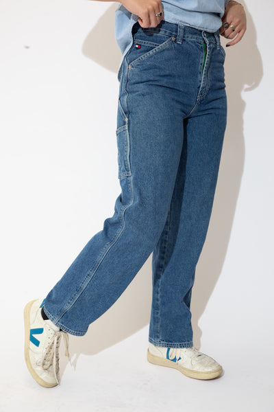 Mid-wash jeans in a straight leg fit with white stitching, belt loops, plenty of pockets and Tommy branding on the button, domes, carpenters strap and back waistline.