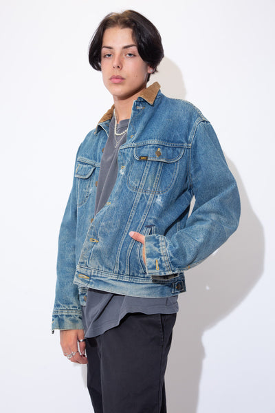 Mid-wash blue denim jacket with a brown corduroy collar, thick inner fleecing, yellow stitching and Lee branding on the buttons and front left pocket.