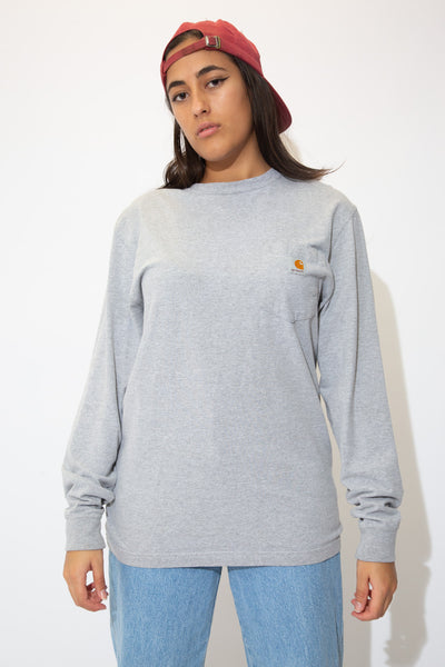 the model wears a long sleeve carhartt tee