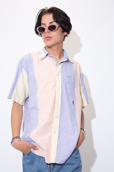 Striped in pastel colours, this dreamy single-stitch button-up has full length white buttons and the Tommy Hilfiger lion emblem below the left chest pocket.