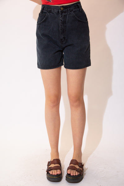 Black high waisted denim shorts with matching black stitching and Stefano branding on the button.