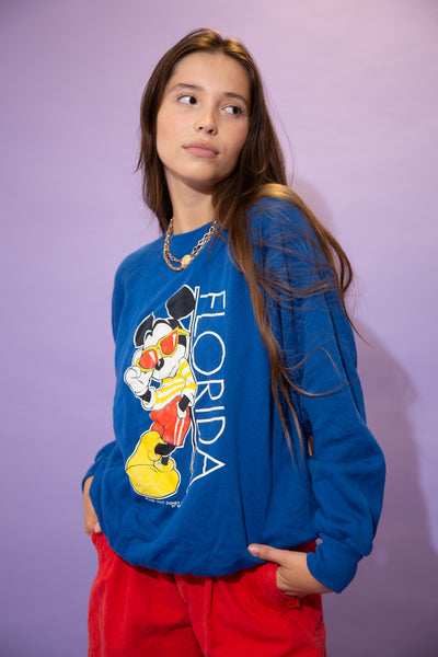Blue in colour, this jumper has a large colour print of a cool looking Mickey Mouse leaning on a vertical 'Florida' spell-out on the front.