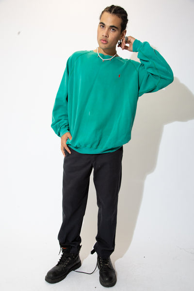 Get rowdy in this Ralph! Green sweater in a crewneck style with a red embroidered Ralph Lauren logo on the left chest.