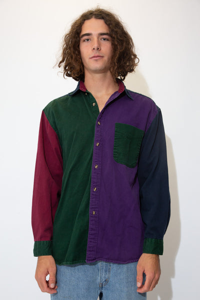 Coloured in purple, navy blue, dark green and maroon, this button-up shirt has full-length brown buttons and a green chest pocket on the left.