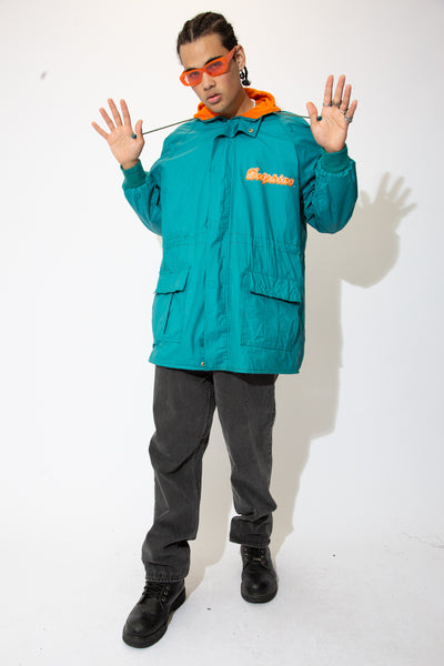 In the signature teal and orange colourway, this jacket has large double pockets, a cosy inner fleece, a hood, draw strings and Dolphins branding on the left chest and back.